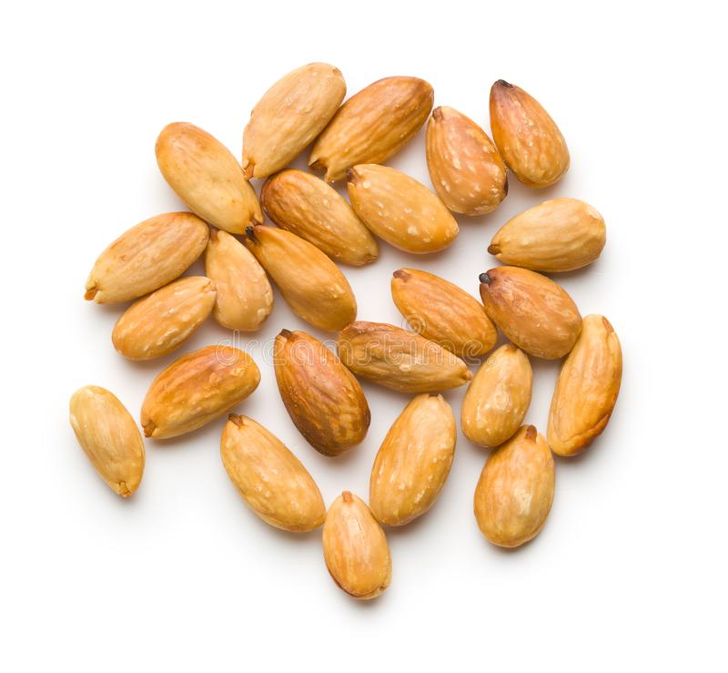Salty roasted almonds. Isolated on white background royalty free stock photo