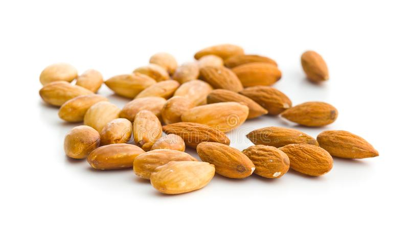 Salty roasted almonds. Salty roasted and unpeeled almonds isolated on white background stock photography