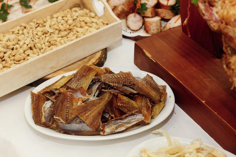 Salty smoked fish on wooden desk on table, wedding reception. be stock photos