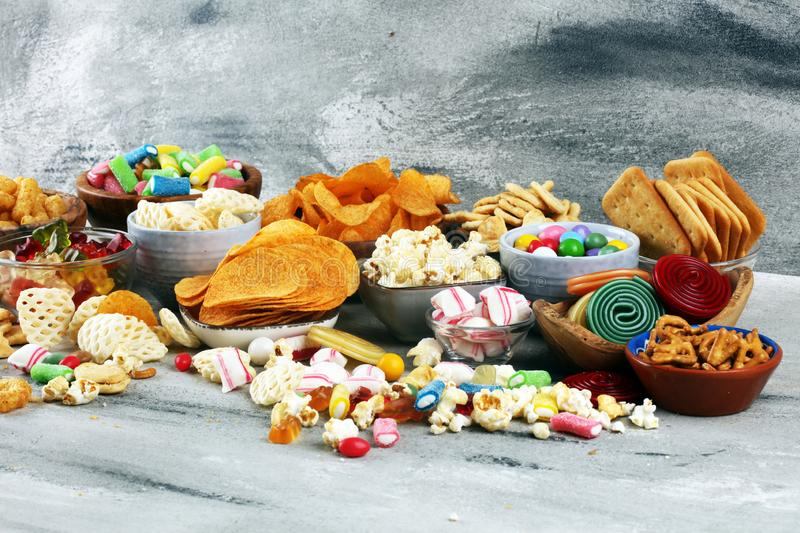 Salty snacks. Pretzels, chips, crackers and candy sweets on table. Salty snacks. Pretzels, chips, crackers and candy sweets. Unhealthy products. food bad for stock image