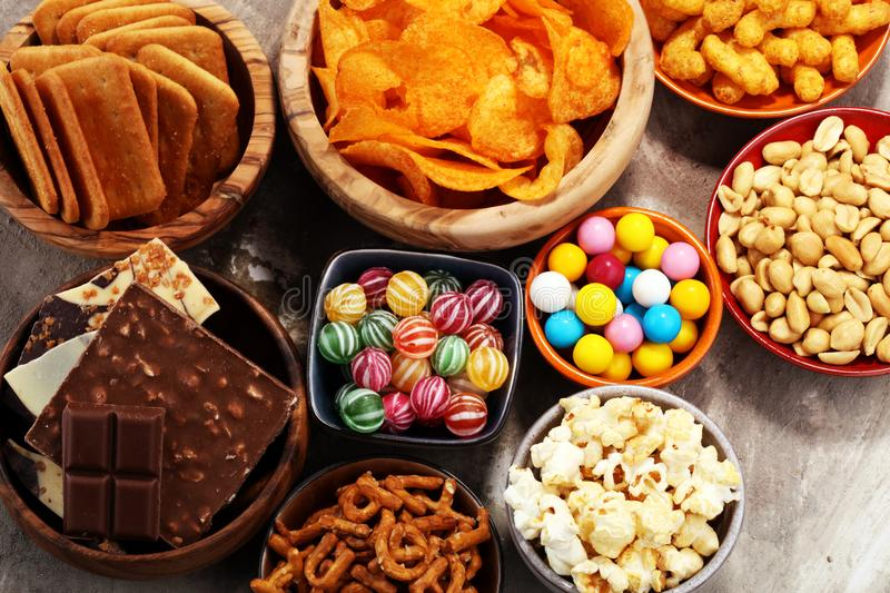 Salty snacks. Pretzels, chips, crackers in wooden bowls. stock photo
