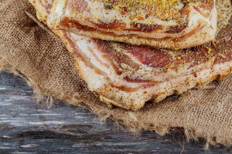 Salty spiced lard on a white plate, Ukrainian cuisine royalty free stock image