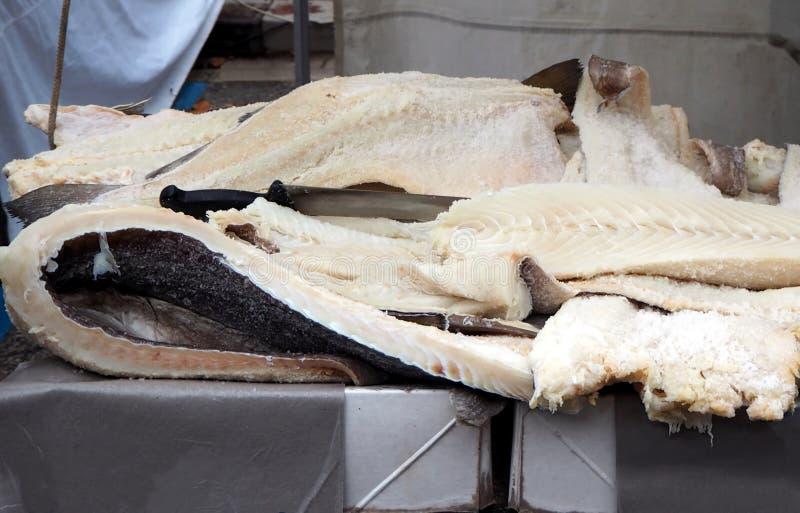 Salty stockfish on the shelf of an italian fishmonger royalty free stock photos