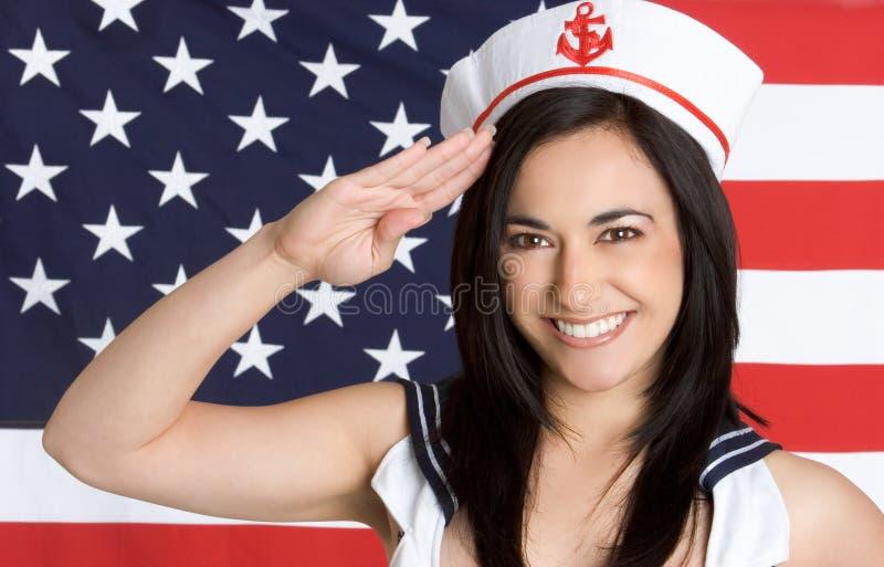 Saludo de la muchacha de la marina imagenes de archivo