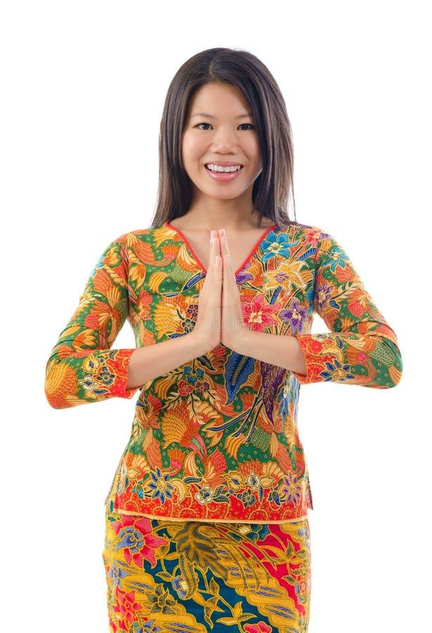 Saludo femenino asiático suroriental imagen de archivo