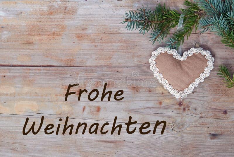 Saludos naturales de la Navidad en alemán - Frohe Weihnachten foto de archivo