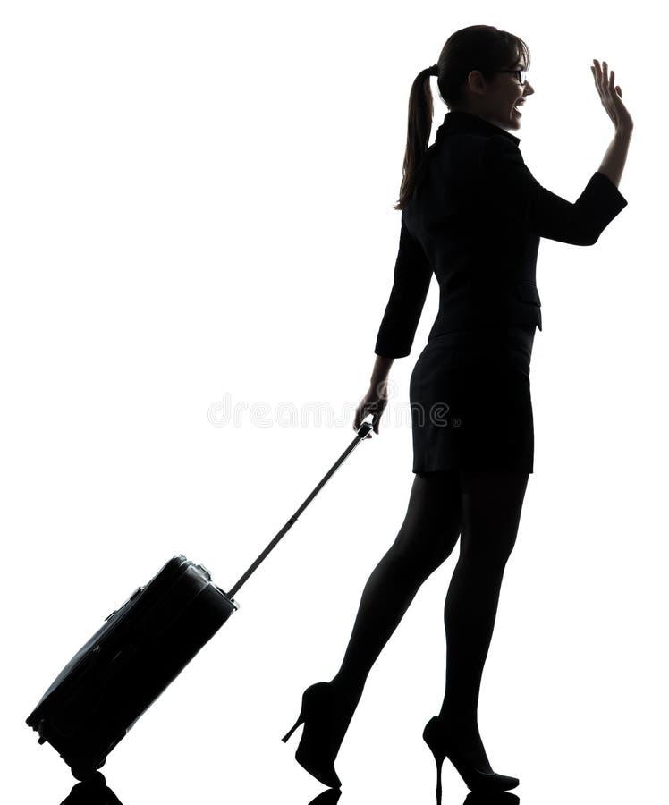 Salutation de déplacement de femme d'affaires   silhouette photo libre de droits