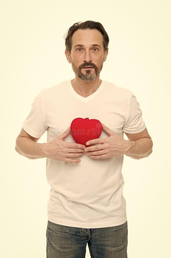 Salutation du coeur sinc?re Coeur barbu de prise de hippie d'homme C?l?brez le jour de valentines Amour et sentiments romantiques photo libre de droits