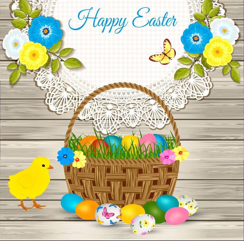 Salutations heureuses de Pâques - panier de Pâques avec des oeufs, poulet jaune, fleurs sur le fond en bois illustration stock