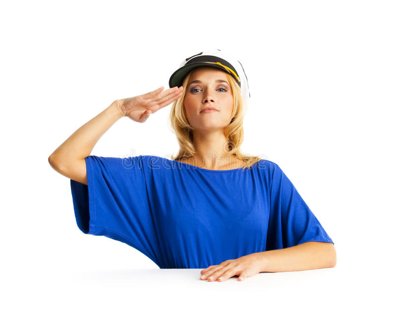 Salute!. Beautiful young woman performing a military hand salute royalty free stock image