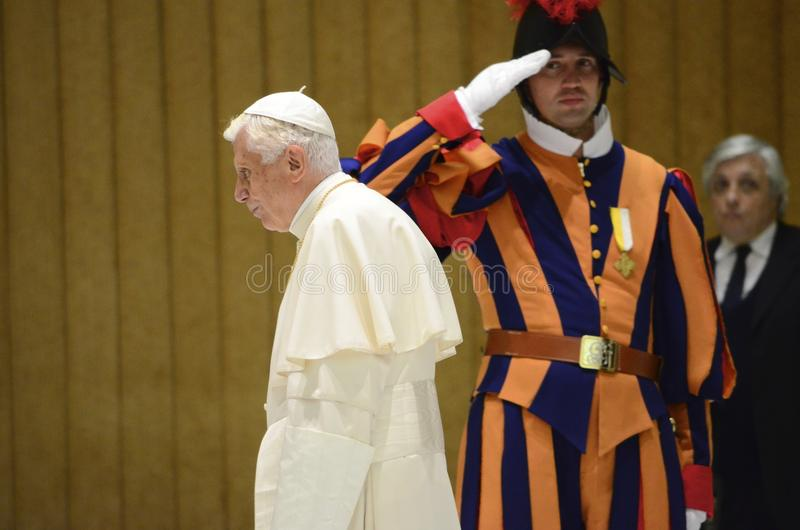 Salute!. Pope Benedict and Swiss Guard on duty in Saint Peters Basilica royalty free stock photos