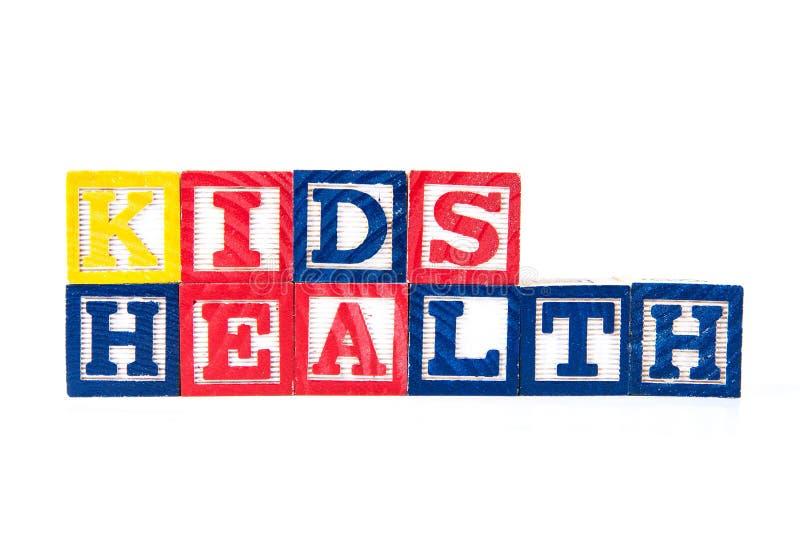Salute dei bambini - blocchetti del bambino di alfabeto su bianco fotografia stock libera da diritti
