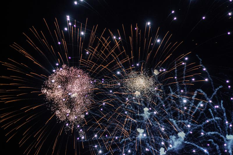 Salute, fireworks in the night sky. Pyrotechnic show on a holiday. Explosion of many firecrackers. Salute, fireworks in the night sky. Explosion of many stock photo