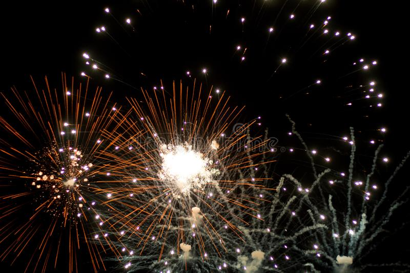 Salute, fireworks in the night sky. Pyrotechnic show on a holiday. Explosion of many firecrackers. Salute, fireworks in the night sky. Explosion of many stock photos