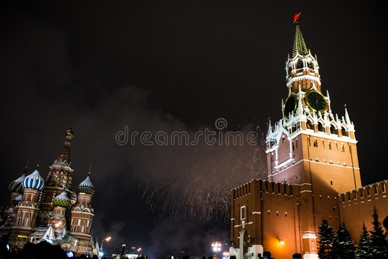 Salute in honor of the new year 2019 on red square against the Kremlin, Spasskaya tower. And St. Basil`s Cathedral stock image