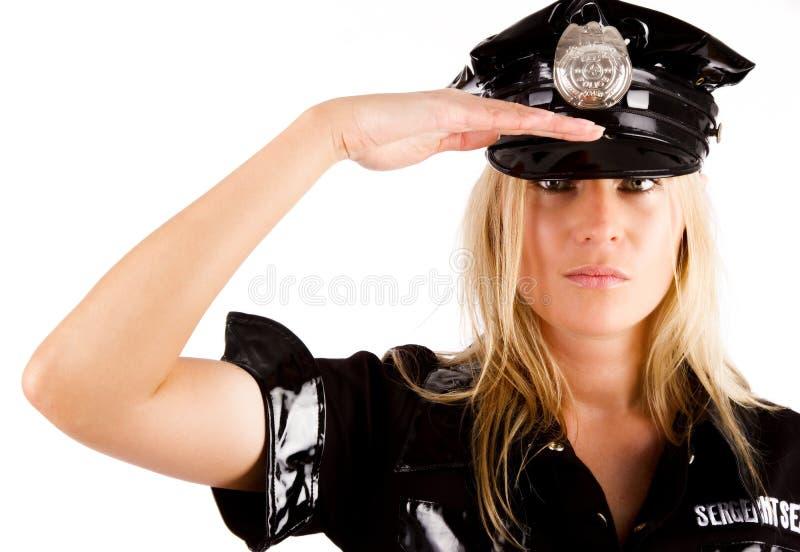 salutera för kvinnlig polis royaltyfri fotografi
