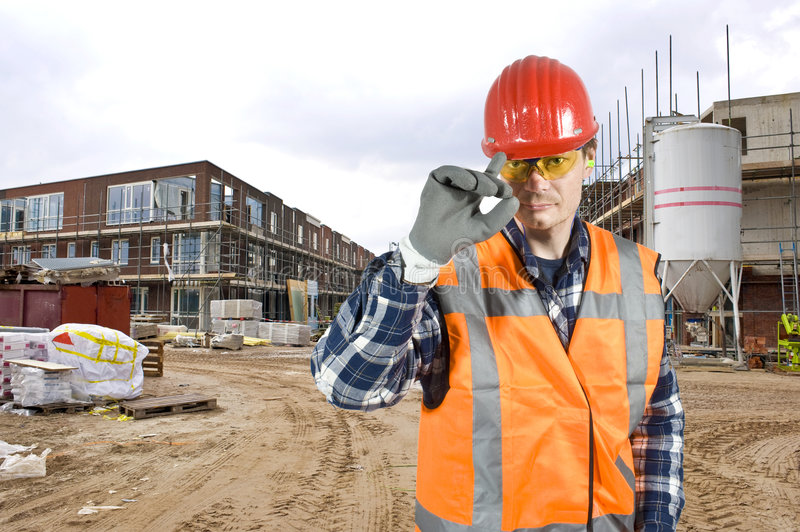 Saluting construction worker royalty free stock photography