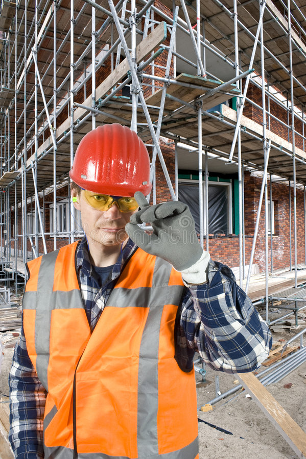 Saluting construction worker stock images