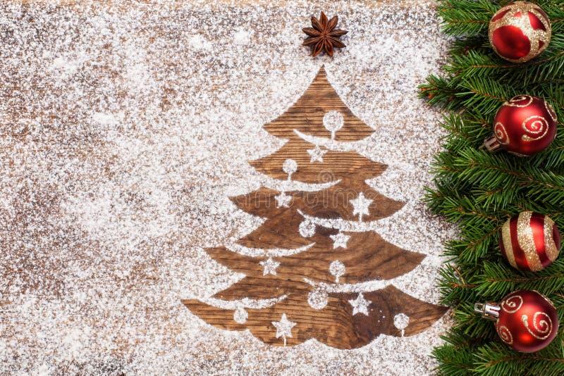 Saluto di Natale con l'albero di natale che assorbe sabbia immagini stock