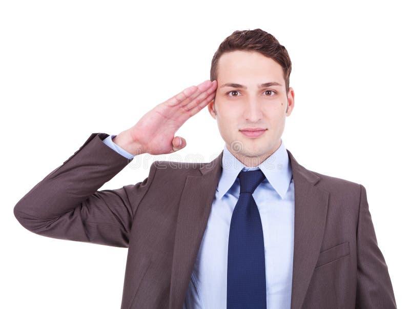 Saluto militare dell'uomo d'affari fotografia stock libera da diritti