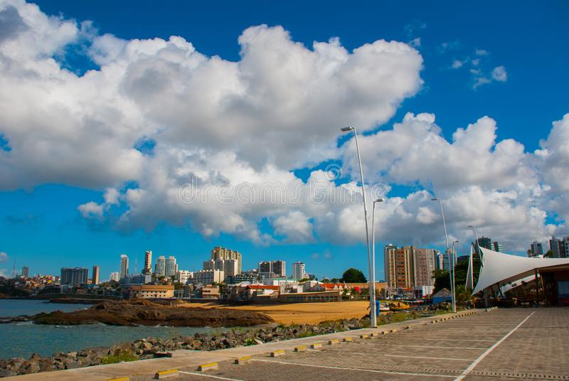 SALVADOR, BAHIA, BRAZIL: City view with modern houses, skyscrapers and the sea in Sunny weather royalty free stock photography