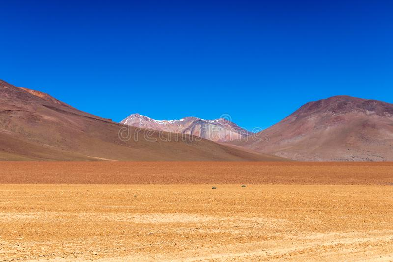 The Salvador Dali desert also known as Dali Valley, in the Eduardo Avaroa Park in Bolivia, Andes in South America. Volcanic landscape of Desierto Salvador Dali royalty free stock image