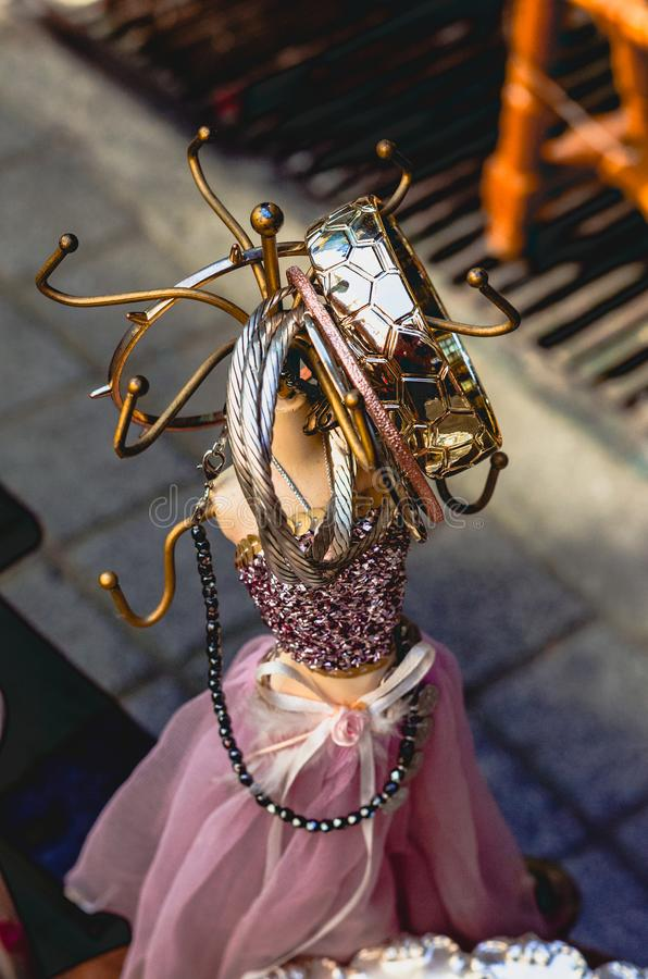Salvage of a doll redesigned and used as a key or ring holder stock image