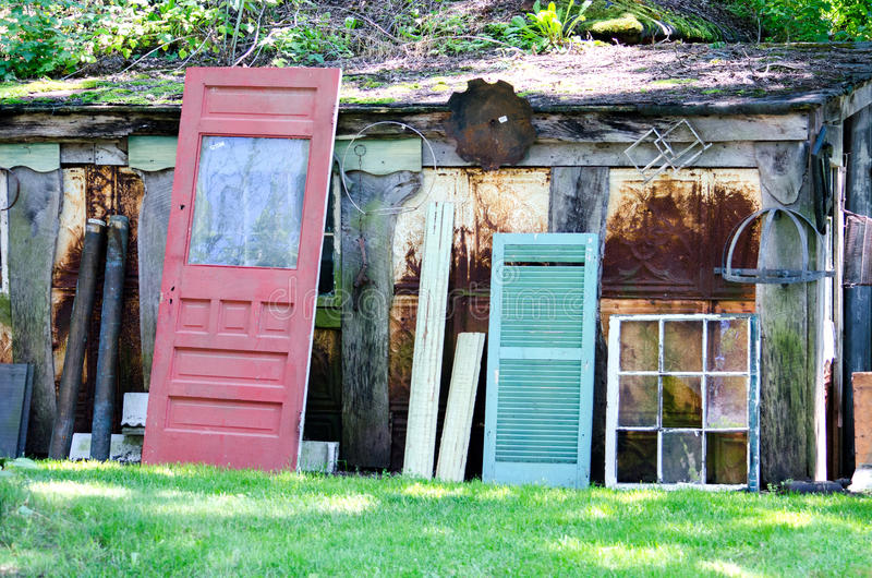Salvage yard with old doors and windows. A salvage yard with old doors and windows for sale helps reduce waste, our carbon footprint, and reuses things from the stock photos