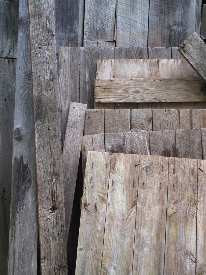 Salvaged Old Boards. A stack of salvaged aged weathered wood royalty free stock images