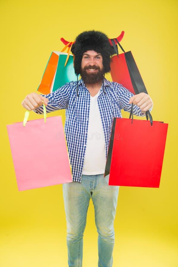 Salvaje sobre compras Paquetes completos de art?culos Toro enojado del sombrero del desgaste de la cara del hombre con los cuerno imagen de archivo libre de regalías