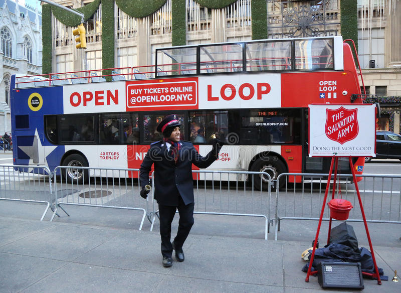 Salvation Army soldier perform for collections in midtown Manhattan. NEW YORK - DECEMBER 15, 2016: Salvation Army soldier performs for collections in midtown royalty free stock images