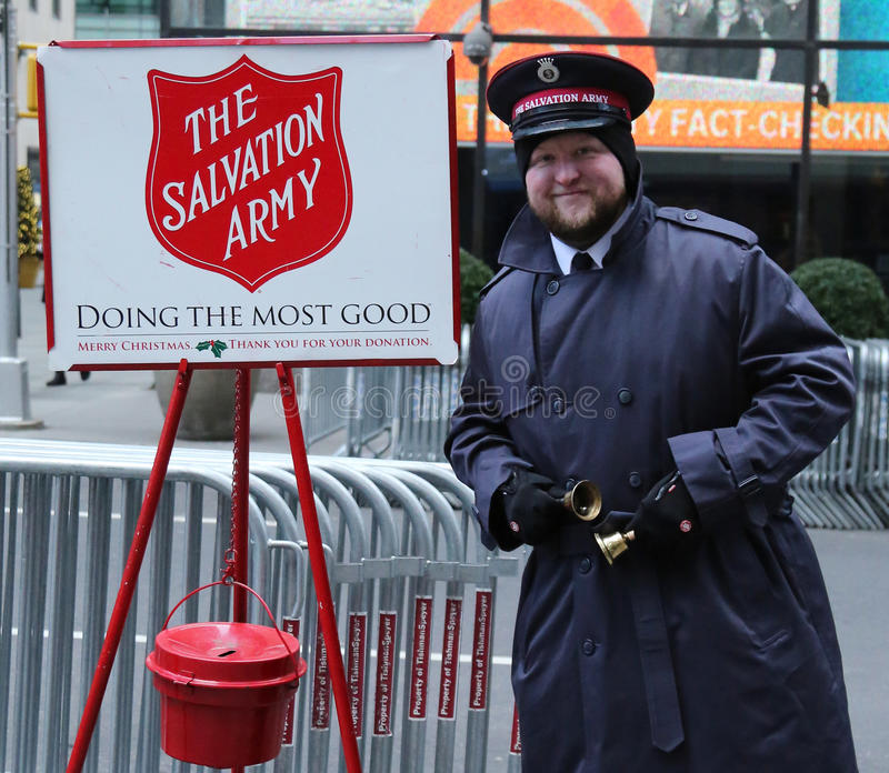 Salvation Army soldier perform for collections in midtown Manhattan. NEW YORK - DECEMBER 15, 2016: Salvation Army soldier performs for collections in midtown stock image