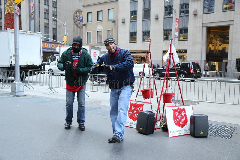 Salvation Army soldier perform for collections in midtown Manhattan. NEW YORK - DECEMBER 15, 2016: Salvation Army soldier performs for collections in midtown stock photography