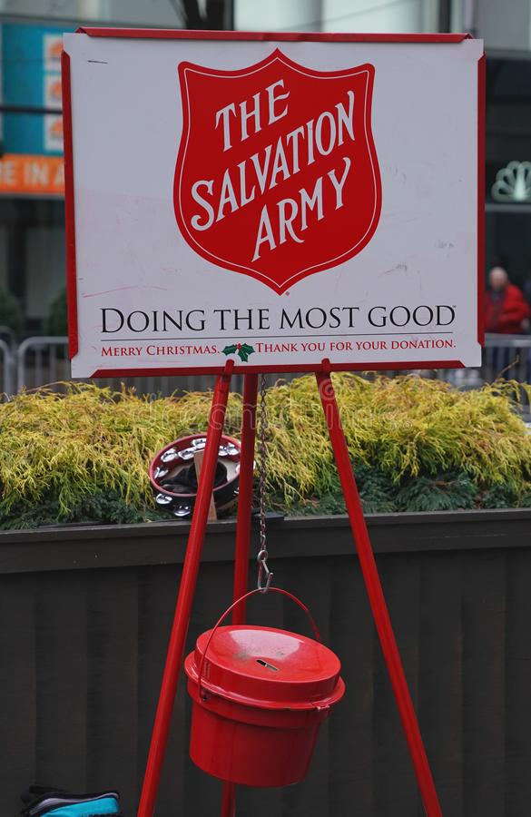 Free Salvation Army Soldier Performs For Collections In Midtown Manhattan Royalty Free Stock Photos - 106335708