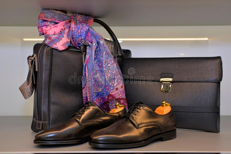 Salvatore Ferragamo for Men, Handmade Leather Shoes and Bags, Purple and Pink Scarf royalty free stock images