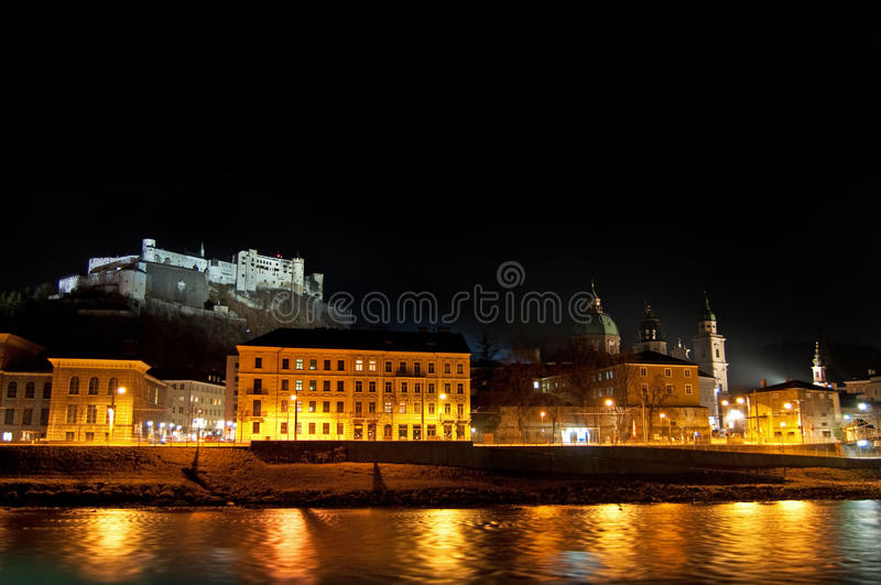 Salzburg. Night view with Salzach river and old fortress stock photography