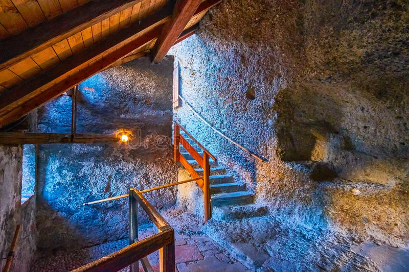 The medieval chambers hewn in the stone in Salzburg, Austria. SALZBURG, AUSTRIA - FEBRUARY 27, 2019: The medieval chambers huwn in rock were one of the oldest royalty free stock photos