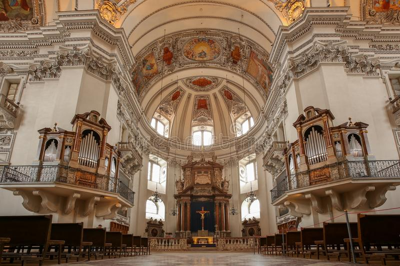 Salzburg Cathedral interior with organ and altar. SALZBURG, AUSTRIA - February 23, 2018: The Salzburg Cathedral Salzburger Dom is a 17th century cathedral stock photo