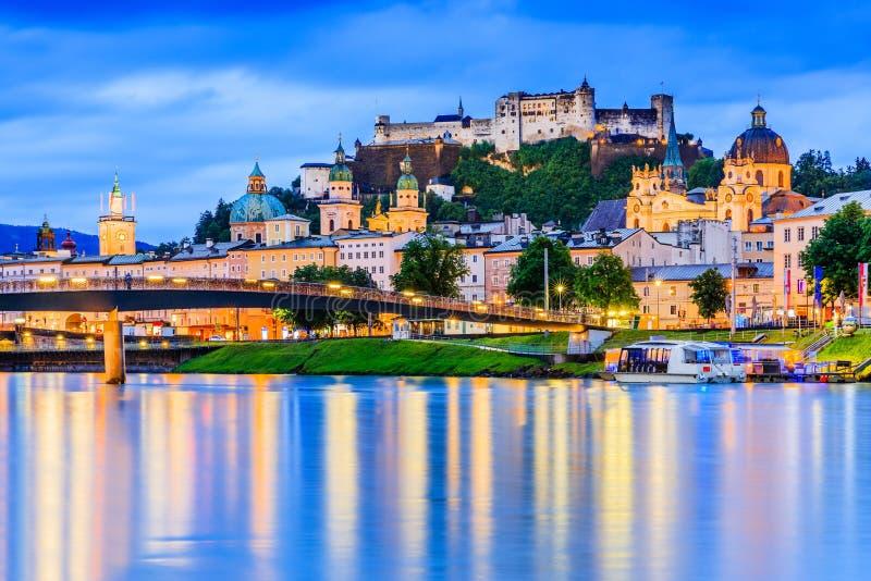 Salzburg, Austria. Festung Hohensalzburg fortress, Salzburger Dom and Salzach river at twilight royalty free stock image