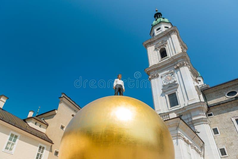 Salzburg, Austria. 19. July 2013: Sphaera is a sclupture by the German Stephan Balkenhol and located at the Kapitelpatz in Salzburg stock photo