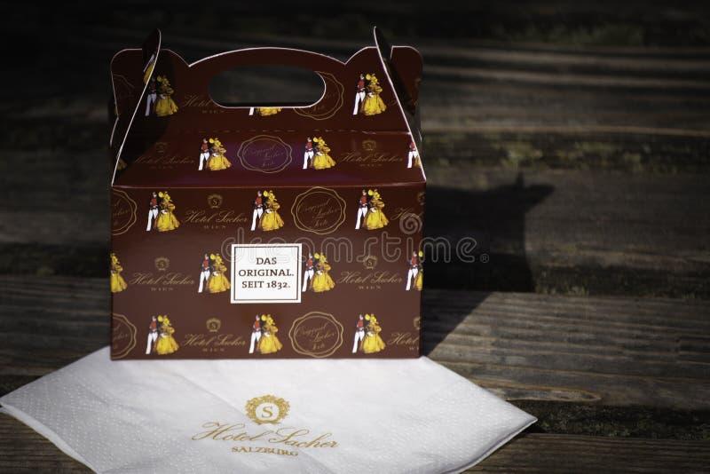 Salzburg, Austria- June 25, 2019: Slice of Sacher torte in paper box. royalty free stock photo