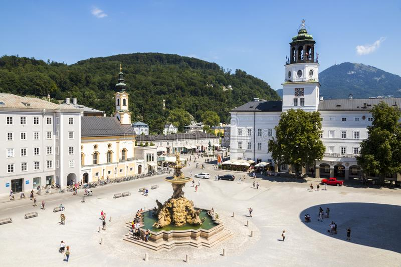 Salzburg, Austria. The Residenzplatz in Salzburg, Austria, with the Church of Saint Michael Michaelskirche, the Residenzbrunnen fountain and the New Residence royalty free stock images