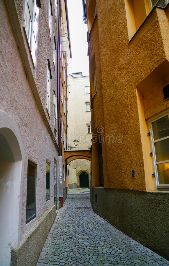 Salzburg street scene. SALZBURG, AUSTRIA - SEPTEMBER 6, 2017; Old town street scene historic buildings border narrow cobbled street stock image