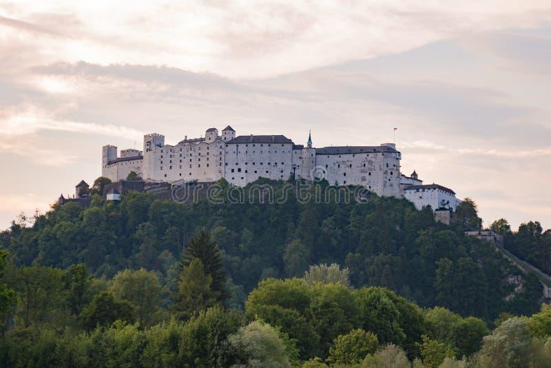 Salzburg castle fortress Hohensalzburg on a hill, sunrise sunset royalty free stock image