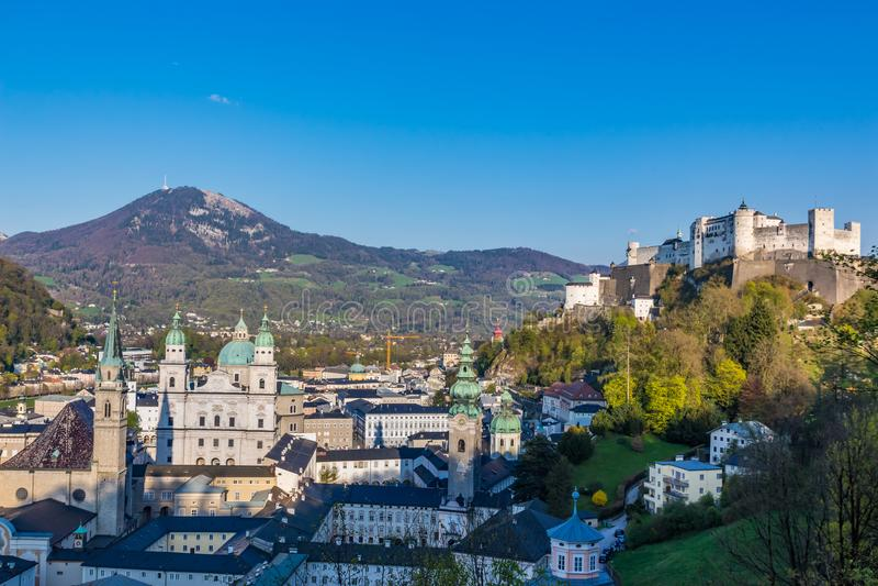 Salzburg Village Valley and Hohensalzburg Castle on Hills Background royalty free stock photos