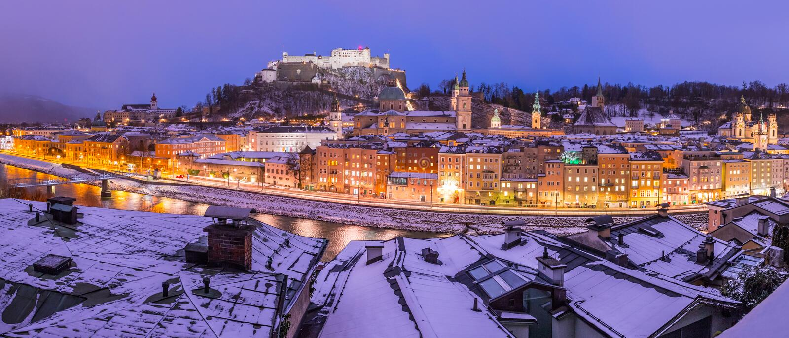 Salzburg winter panorama at christmas time, old city and rooftops in the evening, Austria stock photography