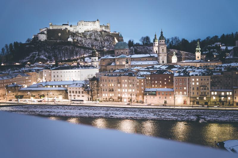Salzburg old city at christmas time, snowy in the evening, Austria. Magic advent alps landscape austrian castle building winter cathedral baroque church stock photo