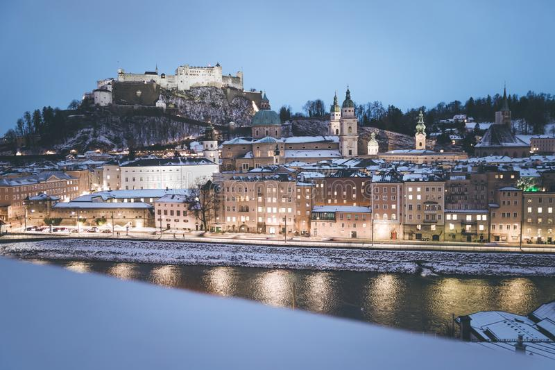 Salzburg old city at christmas time, snowy in the evening, Austria. Magic advent alps landscape austrian castle building winter cathedral baroque church royalty free stock photo