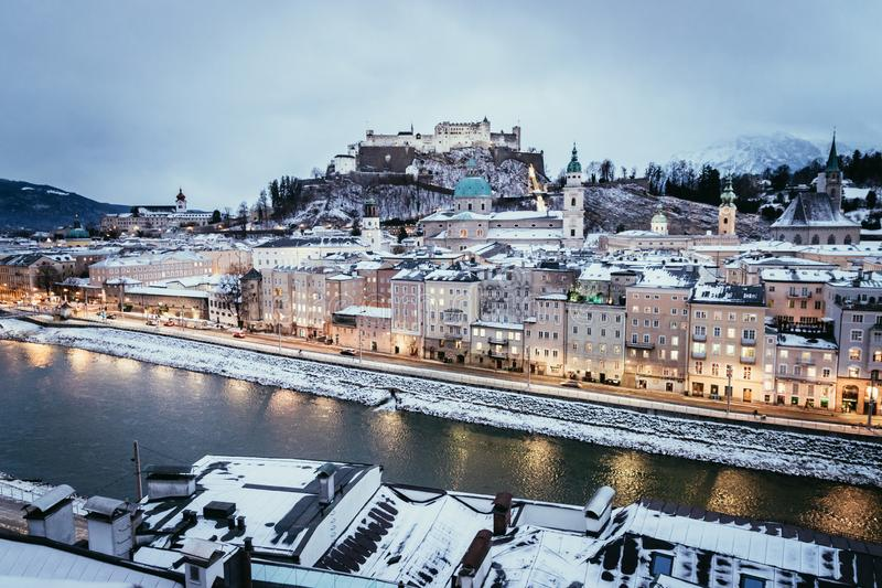 Salzburg old city and rooftops at christmas time, snowy in the evening, Austria. Salzburg old city at christmas time, snowy in the evening, Austria magic advent stock photo