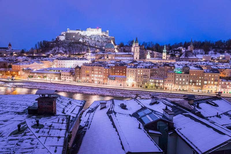 Salzburg old city and rooftops at christmas time, snowy in the evening, Austria. Salzburg old city at christmas time, snowy in the evening, Austria magic advent royalty free stock photos